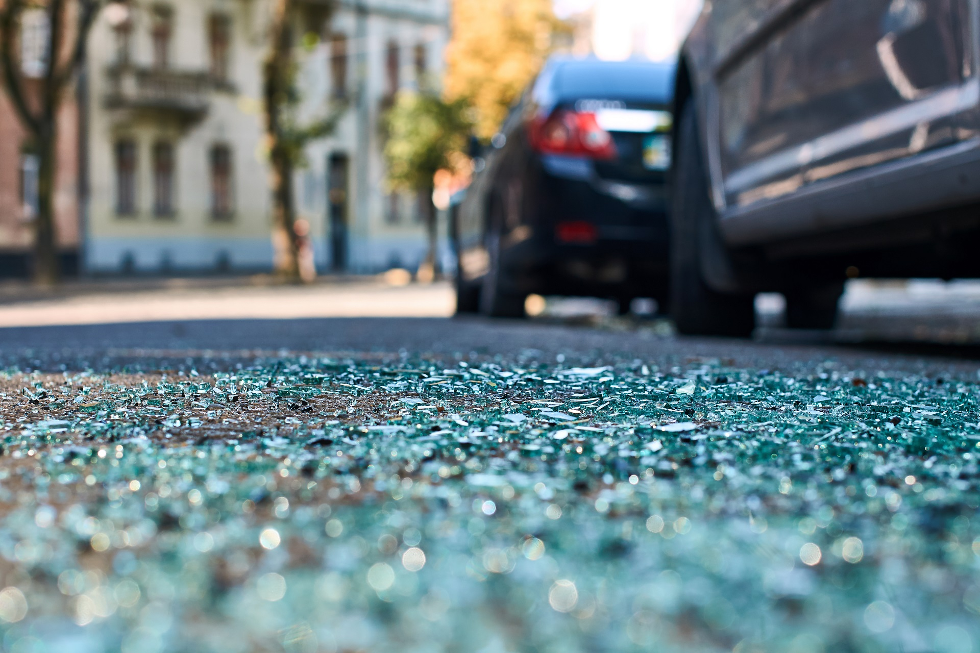 Shards of glass on the street after a car accident