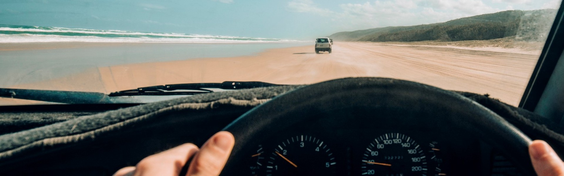 Driving a Bingle insured car on the beach at Fraser Island, Queensland.