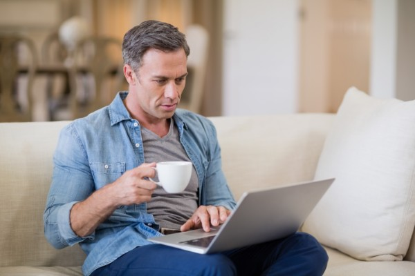 man selects optional extra on computer