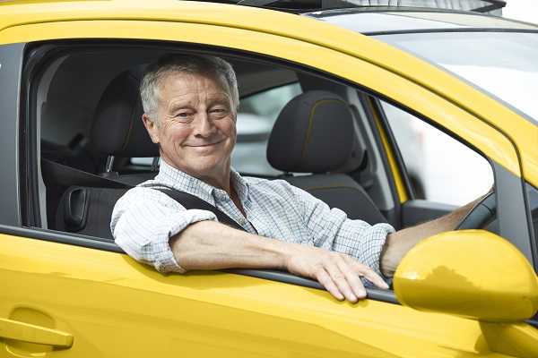 Man in a yellow Bingle insured car in Queensland